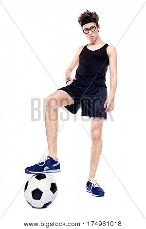 Crazy thin football player standing with a ball. Sports and activities concept. Isolated over white.