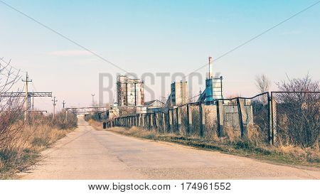 The Road Goes Into The Distance To The Old Abandoned Factory. The Crisis, The Fall Of The Economy, S