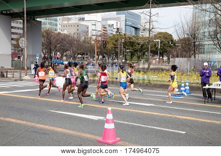 NAGOYA JAPAN - MARCH 13, 2016: Nagoya Women's Marathon 2016. Women's running in the downtown. Course Start and finish at Nagoya Dome Distance 42.195km. Nagoya city Japan.