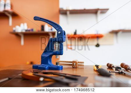 Leathercraft stapler and other tools on workplace