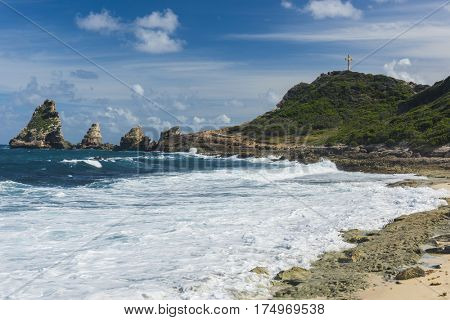 Rocks and hills  of Pointe des Chateaux, the most Eastern point of French island  of Guadeloupe in the Caribbean