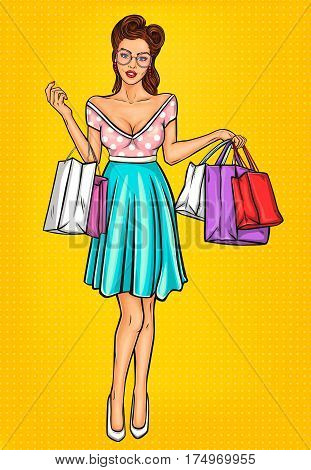smiling pop art girl holding in hands bags with purchases