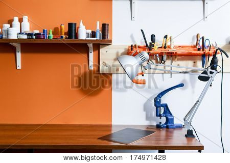 Empty workplace of tanner or repairman