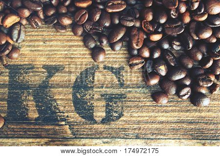 Beans coffe with wooden texture. Raw coffe with symbol weight in grams.