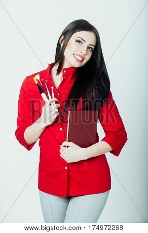 Sexy Pretty Brunette Woman With Brush Set And Notebook