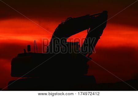 EXCAVATOR - construction machine at dusk on construction site