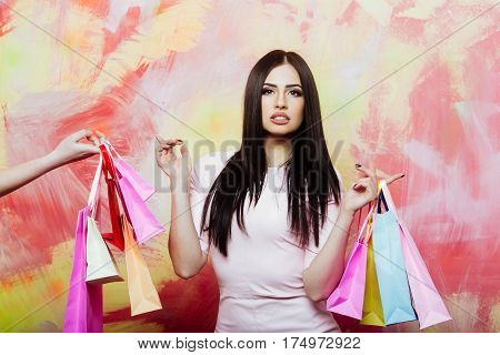 Pretty Sexy Woman With Shopping Bags On Colorful Background