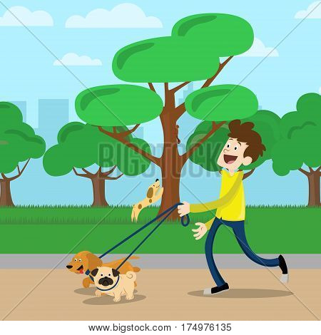 Young man in yelllow t-shirt walking two dog in park