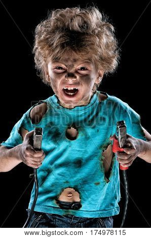 Portrait of funny little electrician with cord plug over black background. Electricity power concept.