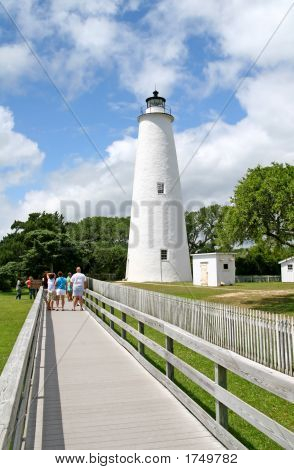 Ocracoke Island Lighthouse with wooden walkway and people poster