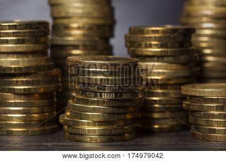 Stacks Of Gold Coins On Black Background
