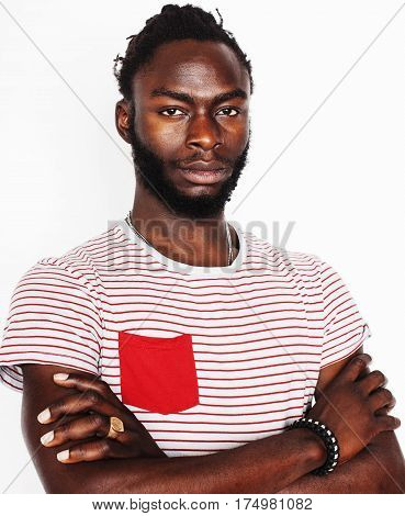 young handsome afro american boy gesturing emotional isolated on white background smiling, lifestyle real people concept close up