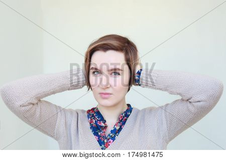 Girl In A Panic Closing Ears With Her Hands, Trying To Focus
