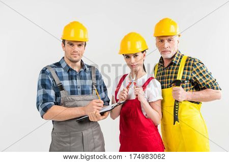 Group of professional male and female construction workers looking at camera