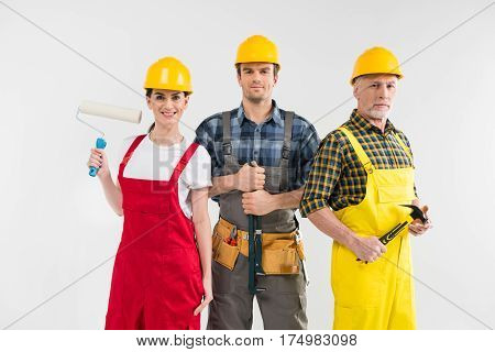 Group of professional male and female construction workers smiling at camera