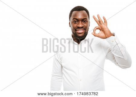 Image of attractive young african man dressed in shirt standing with okay gesture isolated over white background.