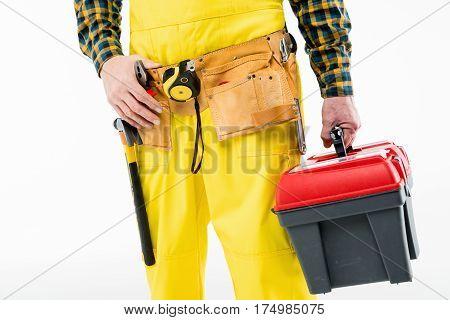 Partial view of workman holding tool kit on white