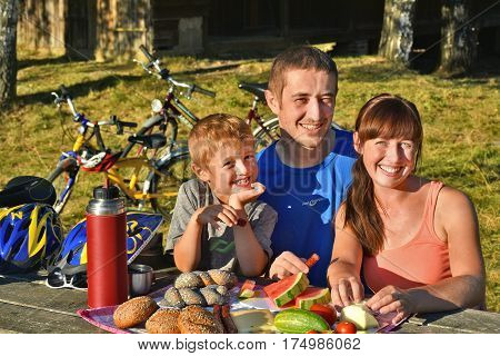 DOBERSBERG AUSTRIA - AUGUST 2016: Family with boy having a picnic in summer after bicycle tour. Photo was taken next to the new bike path Thayarunde in Lower Austria.
