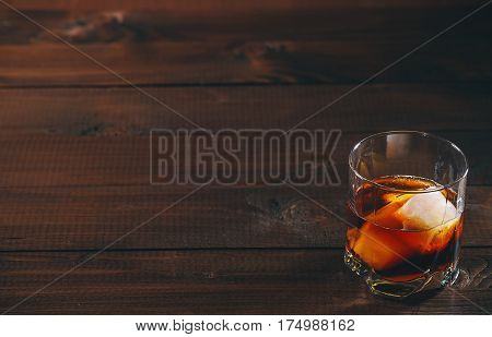 Cola With Cognac Or Rom In Glass And Ice Cubes On Wooden Table. Free Space