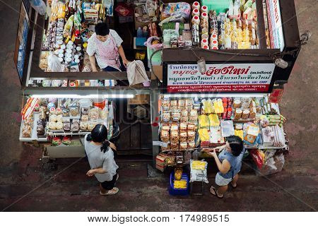 CHIANG MAI THAILAND - AUGUST 27: The group of vendors wait for customers at the Warorot market on August 27 2016 in Chiang Mai Thailand.