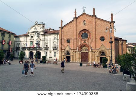 People Walking In Front Of The  Church At Asti