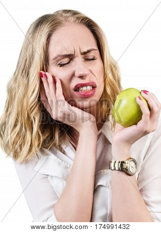 Woman feels toothpain because of sensitive gums and eating green apple.