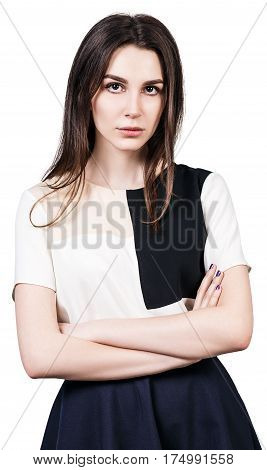 Serious young woman with crossed hands over white background
