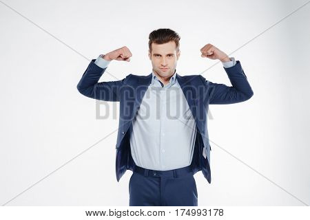 Man in blue suit which showing his biceps and looking at camera. Isolated white background