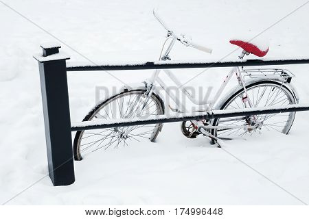 White Bicycle Parked In Snowdrift