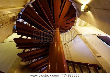 Wooden spiral staircase with handrail Antique Architecture interior