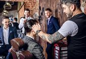 Master makes hair style in barbershop salon. Close up photo. poster
