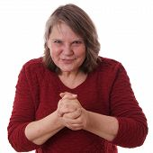 mature woman with devious smile rubbing hands poster