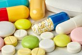 Pills pharmacy collection on paper background. Colorful different size kinds drugs antibiotic macro view photo poster