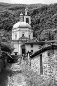 The historic church of Santa Croce at Riva San Vitale (Ticino Switzerland) along the Lake of Lugano (Ceresio) built in 16th century. Black and white poster