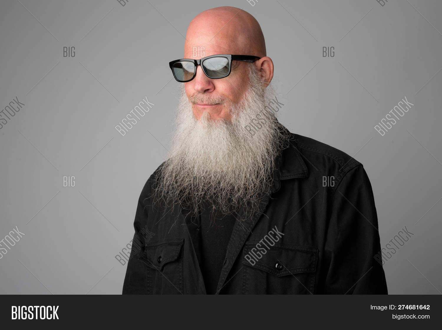 Face Of Mature Bald Bearded Man With Sunglasses Thinking And Looking Away