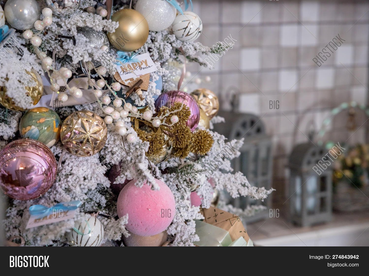 Close Up Of Christmas Tree Decoration With Gold, Silver, Pink And White Tinsel,