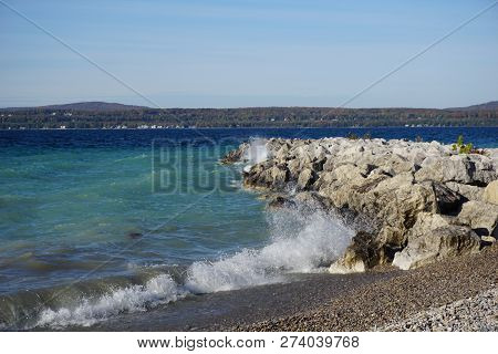 Boulders Serve As A Breakwall To Protect The Bay View Swimming Beach From The Effect Of Waves, In Ba