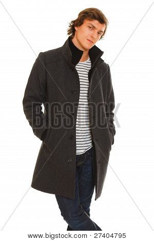 Portrait Of Thoughtful Guy In Winter Coat