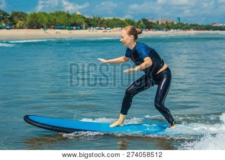 Joyful Young Woman Beginner Surfer With Blue Surf Has Fun On Small Sea Waves. Active Family Lifestyl