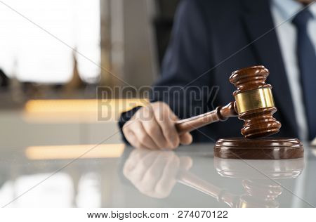 Lawyer Concept Background. Lawyer Working At The Office. Gavel On The White Glass Table.