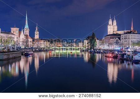 Panoramic View Of Historic Zurich City Center With Famous Fraumunster Church And River Limmat At Lak