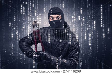Burglar in action with encoded concept and his tools in his hand.