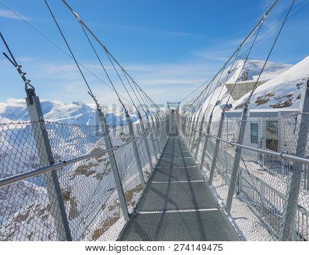 Suspension Bridge Along The Cliff Of Mt. Titlis In Switzerland In Winter.