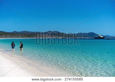 Whitsundays, Australia - August 24th: Tourists Enjoying The Clear Blue Water And White Silicon Sand