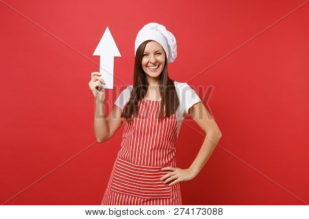 Housewife Female Chef Cook Or Baker In Striped Apron, White T-shirt, Toque Chefs Hat Isolated On Red
