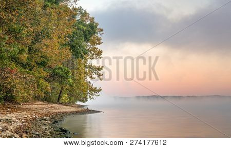foggy sunrise over water - Tennesse River at Natchez Trace Parkway