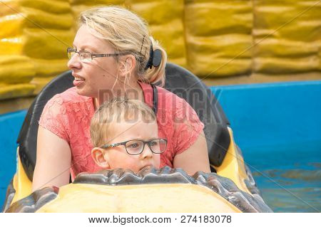 A Caucasian Mother And Her Son Enjoying At Amusment Park