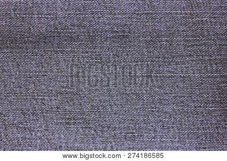 Denim Jean Background Pattern Of Pale Grey Color. Classic Jeans Texture Fabric Close Up View Of Empt
