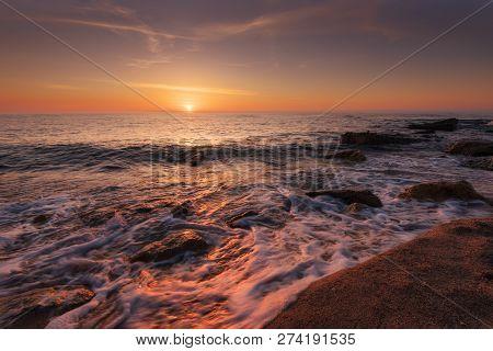 Seascape During Sunrise. Beautiful Natural Seascape, Blue Hour. Sea Sunrise At A Black Coast Near Va