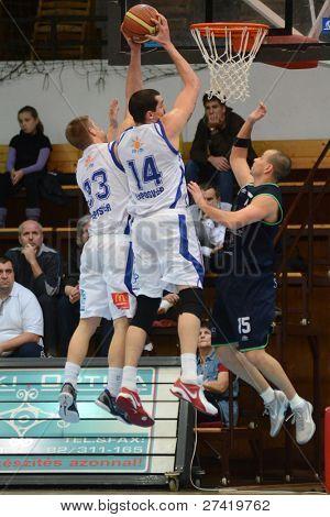 KAPOSVAR, HUNGARY - DECEMBER 10: Jozsef Lekli (14) in action at a Hungarian Championship basketball game Kaposvar (white) vs. Szeged (blue) on December 10, 2011 in Kaposvar, Hungary.